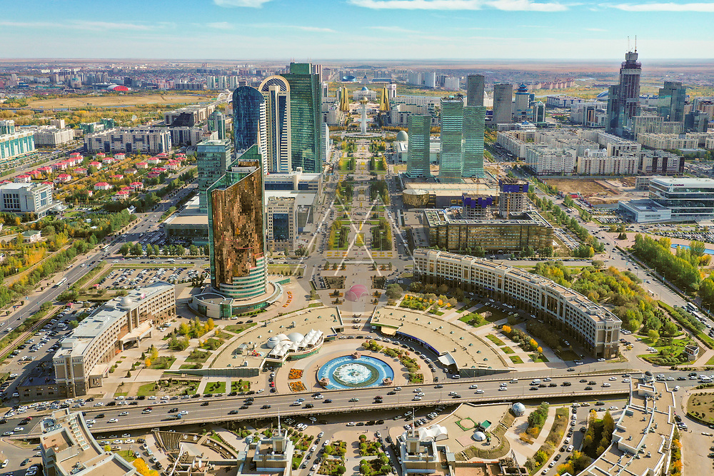 Aerial view of the Entertainment Centre, Nur Sultan, Kazakhstan. Taken in autumn as the leaves turn to a golden colour. With views towards the Bayterek tower.
