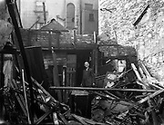 25/04/1958<br /> 04/25/1958<br /> 25 April 1958<br /> Fire at Ormond Quay, Dublin. Happy man amongst the ruins.