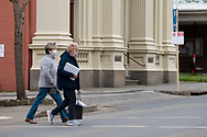 Locals cross the street during COVID-19 in Kilmore, Australia. An outbreak which started in Chadstone in Melbourne, has spread as far as Benalla. Twenty-eight people linked to the outbreak have now tested positive for COVID-19. There are now two confirmed cases in Kilmore linked with a Melbourne Resident who carried the virus into the town. The person visited the Odd Fellows Cafe in Kilmore which lead to him spreading the virus to a staff member, and a customer. The cafe has been closed for deep cleaning and will remain closed until the 19th October. (Photo by Dave Hewison/Speed Media)