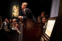 Jussi Pylkkanen, President and auctioneer, Christie's. On the wall JA - WAS? - BILD by KURT SCHWITTERS (1887-1948)