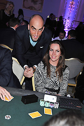 DRUMMOND MONEY-COUTTS and LIV BOEREE at the Quintessentially Foundation poker evening at The Savoy Hotel, London on 30th October 2012.