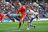 Matthew Connolly of Cardiff City clears the ball under pressure from Jordan Hugill of Preston North End. Skybet football league championship match, Preston North End v Cardiff City at the Deepdale stadium in Preston, Lancashire on Saturday 17th October 2105.<br /> pic by Chris Stading, Andrew Orchard sports photography.