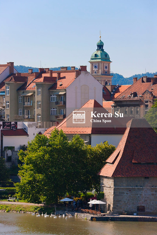 Red roofed houses and Water Tower (Vodni Stolp) in historic neighborhood of Lent by Drava River, Maribor, Slovenia
