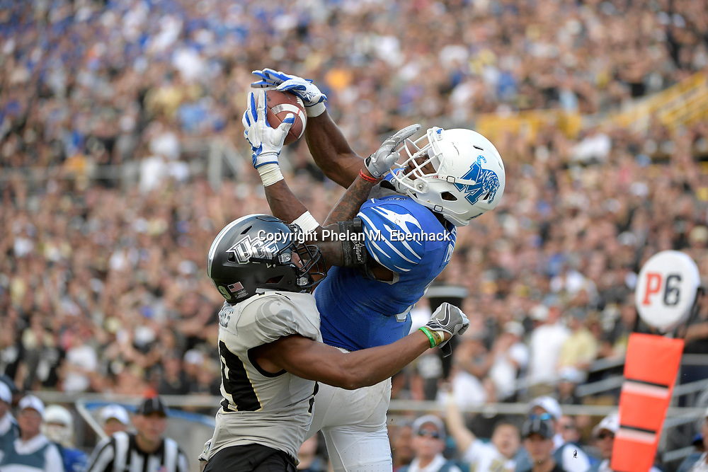 Memphis wide receiver Anthony Miller (3) catches a pass in the end zone for a 10-yard touchdown in front of Central Florida defensive back Mike Hughes (19) during the second half of the American Athletic Conference championship NCAA college football game Saturday, Dec. 2, 2017, in Orlando, Fla. Central Florida won 62-55. (Photo by Phelan M. Ebenhack)