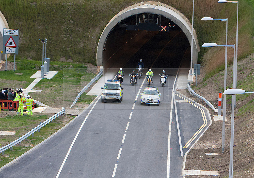 © Licensed to London News Pictures. 27/07/2011. Hindhead, Surrey, UK. Today (Wednesday) The £371 Million Hindhead Tunnel project officially opens to the public. Pictured: The first traffic comes through the Southern Portal with a police escort. Photo credit: Sam Spickett/LNP