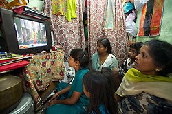 LOCATION, Pant Nagar, New Delhi, India  29/04/2011. The Royal Wedding of HRH Prince William to Kate Middleton. Residents of Pant Nagar a small colony in South Delhi watch the marriage on TV of Britain's Prince William with his fiancee Catherine Middleton at London's Westminster Abbey..Photo credit should read: LNP. Please see special instructions. © under license to London News Pictures