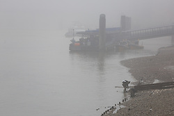 © Licensed to London News Pictures. 17/12/2016. LONDON, UK.  The River Thames near the Tower of London is  seen during foggy weather this morning. London and the River Thames was shrouded in thick fog this morning.  Photo credit: Vickie Flores/LNP