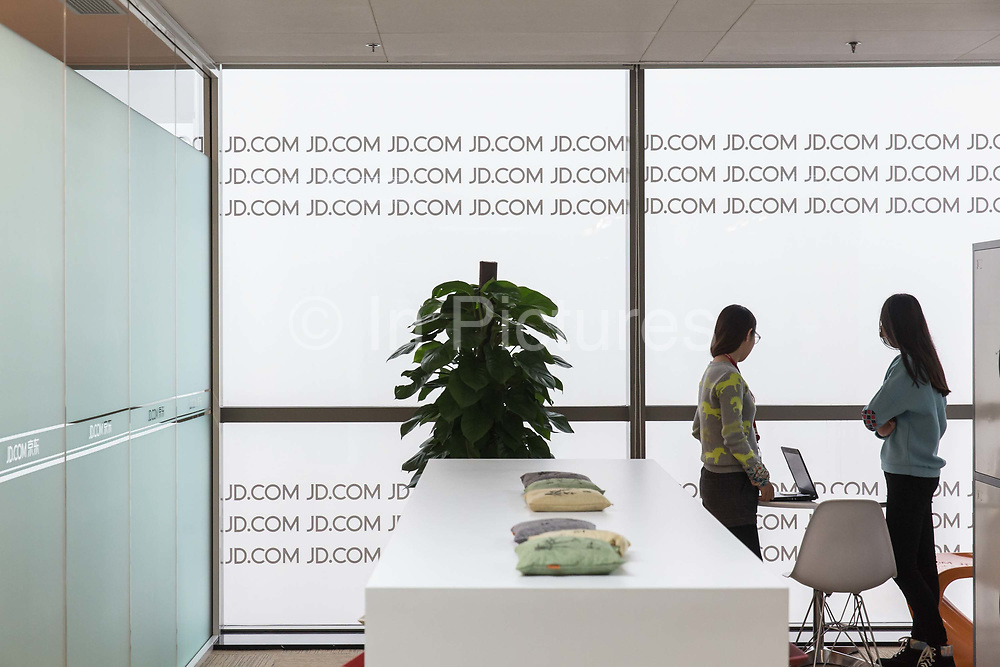 Employees use a lounge at JD.coms headquarters in Beijing, China, on Monday, Nov. 30, 2015.  JD.com is Chinas second largest online retailer and is locked in a fierce battle with rival Alibaba.
