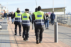 © Licensed to London News Pictures. 10/01/2021. Brighton, UK. Local authority covid marshals patrol the seafront at Brighton on the south coast during the third national lockdown. Photo credit: Liz Pearce/LNP