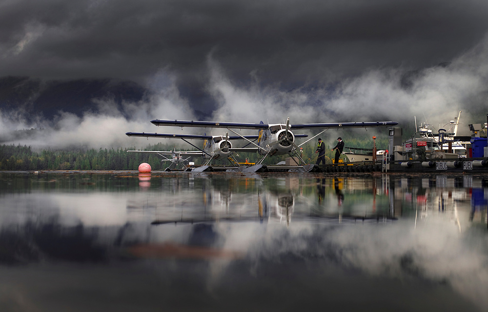 The crew prepares a deHavilland Beaver floatplane for a flight after stormy weather begins to clear in Sechelt, B.C. (2016)
