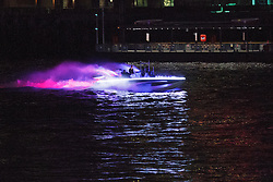 © Licensed to London News Pictures. 25/07/2012. London, UK. A colourful illuminated boat passes down the River Thames on 24 July 2012 in a rehearsal event believed to be related to the opening ceremony of the London 2012 Olympic Games. Photo credit : Vickie Flores/LNP
