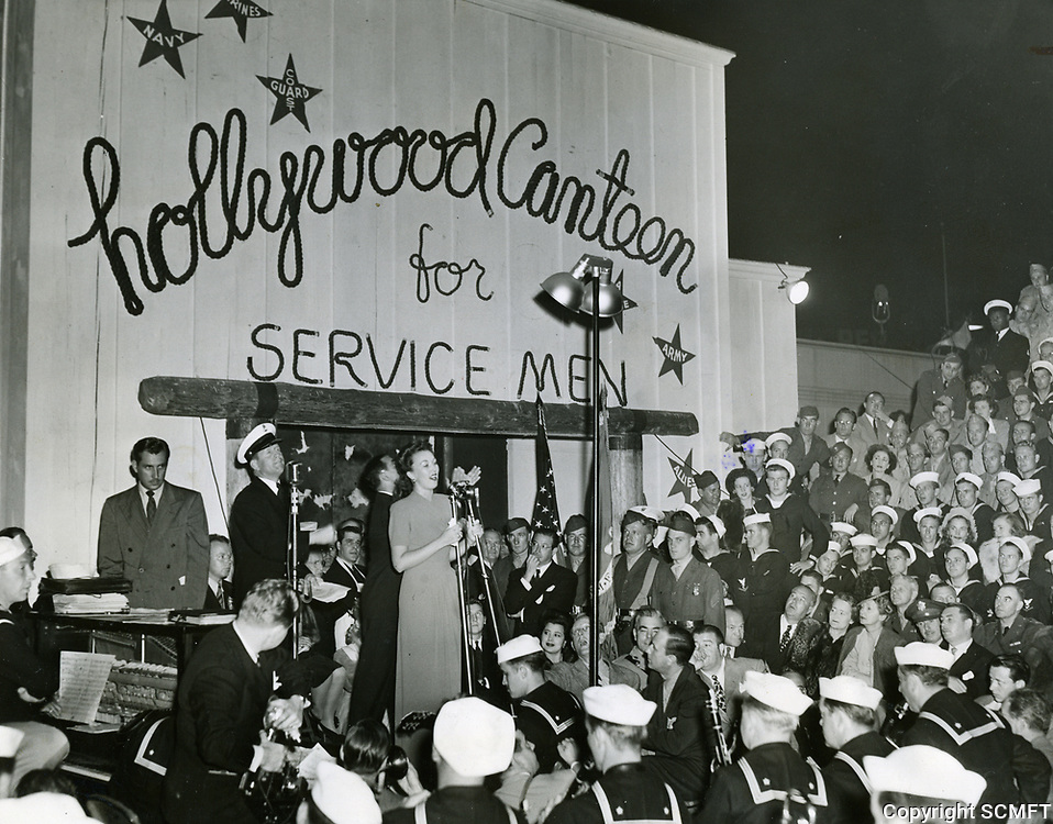 10/3/42 Ginny Simms belts out a song during the grand opening of the Hollywood Canteen
