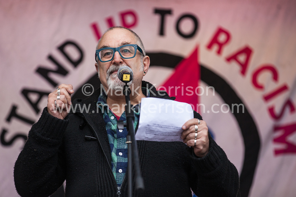 London, UK. 16th March, 2019. David Rosenberg of the Jewish Socialist Group addresses thousands of people on the March Against Racism demonstration on UN Anti-Racism Day against a background of increasing far-right activism around the world and a terror attack yesterday on two mosques in New Zealand by a far-right extremist which left 49 people dead and another 48 injured.