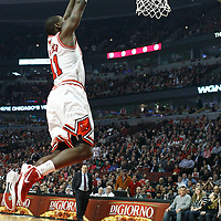 26 March 2012: Chicago Bulls shooting guard Ronnie Brewer (11) dunks for the dunk during the Denver Nuggets 108-91 victory over the Chicago Bulls at the United Center, Chicago, Illinois, USA. NOTE TO USER: User expressly acknowledges and agrees that, by downloading and or using this photograph, User is consenting to the terms and conditions of the Getty Images License Agreement. Mandatory Credit: 2012 NBAE (Photo by Chris Elise/NBAE via Getty Images)
