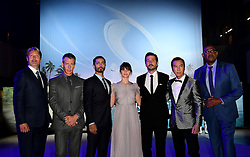 The cast of (left-right) Mads Mikkelsen, Ben Mendelsohn,  Riz Ahmed, Felicity Jones, Diego Luna, Donnie Yen and Forest Whitaker attending the premiere of Rogue One: A Star Wars Story at the Tate Modern, London. PRESS ASSOCIATION Photo. Picture date: Tuesday December 13, 2016. See PA story SHOWBIZ Rogue One. Photo credit should read: Ian West/PA Wire