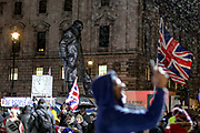 January 31, 2020, London, England, United Kingdom: Dozens of pro-Brexit supporters celebrate UK's departure from the EU at the Winston Churchill's statue in London, Friday, Jan. 31, 2020. Britain officially leaves the European Union on Friday after a debilitating political period that has bitterly divided the nation since the 2016 Brexit referendum. (Credit Image: © Vedat Xhymshiti/ZUMA Wire)