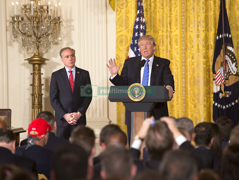 June 23, 2017 - Washington, District of Columbia, United States of America - United States President Donald J. Trump speaks about US Department of Veterans Affairs Secretary Dr. David Shulkin before signing the Department of Veterans Affairs Accountability and Whistleblower Protection Act of 2017 at The White House in Washington, DC, June 23, 2017. Credit: Chris Kleponis / CNP (Credit Image: © Chris Kleponis/CNP via ZUMA Wire)