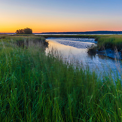 Dawn near Moody Point at the Nature Conservancy's Lubberland Creek Preserve in Newmarket, New Hampshire. Tidal creek in salt marsh.