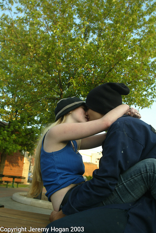 Tina Norris, 15, and George Langely, 15, kiss at people's park.