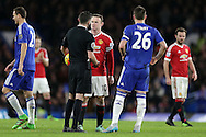 Wayne Rooney, the Manchester United captain and John Terry, the Chelsea captain talking to Referee Michael Oliver. Barclays Premier league match, Chelsea v Manchester Utd at Stamford Bridge in London on Sunday 7th February 2016.<br /> pic by John Patrick Fletcher, Andrew Orchard sports photography.