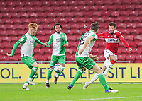 Middlesbrough's Marvin Johnson crosses the ball under pressure from Millwall's Ryan Woods Alex Pearce and Mahlon Romeo<br /> <br /> Photographer Lee Parker/CameraSport<br /> <br /> The EFL Sky Bet Championship - Middlesbrough v Millwall - Saturday 12th December 2020 - Riverside Stadium - Middlesbrough<br /> <br /> World Copyright © 2020 CameraSport. All rights reserved. 43 Linden Ave. Countesthorpe. Leicester. England. LE8 5PG - Tel: +44 (0) 116 277 4147 - admin@camerasport.com - www.camerasport.com