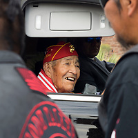 PFC (Ret.) Alfred Newman smiles as he greets parade-goers  and members during the Navajo Code Talkers Parade in Window Rock, AZ on Aug. 14, 2018.