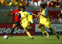 Photo Aidan Ellis.<br />Manchester United v Club America. (at The Coliseum Stadium in Los Angeles). 27/07/03.<br />United's David Bellion and Club America's Jose De Jesus Mendora battle for the ball