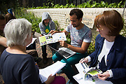 A consultation meeting ahead of the planting of a community garden in Brondebury Park train station 22nd May 2016,London,United Kingdom. At the meeting are local residents, Repowering London representatives and the station manager. Repowering London and their Energy Garden project in the making. Energy Gardens is a pan-London community garden project where reclaimed land alongside over ground train stations and track are cultivated by local community groups. Up 50 gardens are projected with the rail network being the connection grid. The project is a collaboration between Repowering London, Groundwork, local community groups, station managers working for Transport For London and Network Rail.