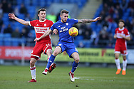 Joe Ralls of Cardiff city ® holds off Jonny Howson of Middlesbrough . EFL Skybet championship match, Cardiff city v Middlesbrough at the Cardiff city Stadium in Cardiff, South Wales on Saturday 17th February 2018.<br /> pic by Andrew Orchard, Andrew Orchard sports photography.