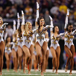 Jan 7, 2011; Arlington, TX, USA; The LSU Tigers Golden Girls dance team  performs prior to kickoff of the 2011 Cotton Bowl against the Texas A&M Aggies at Cowboys Stadium.  Mandatory Credit: Derick E. Hingle