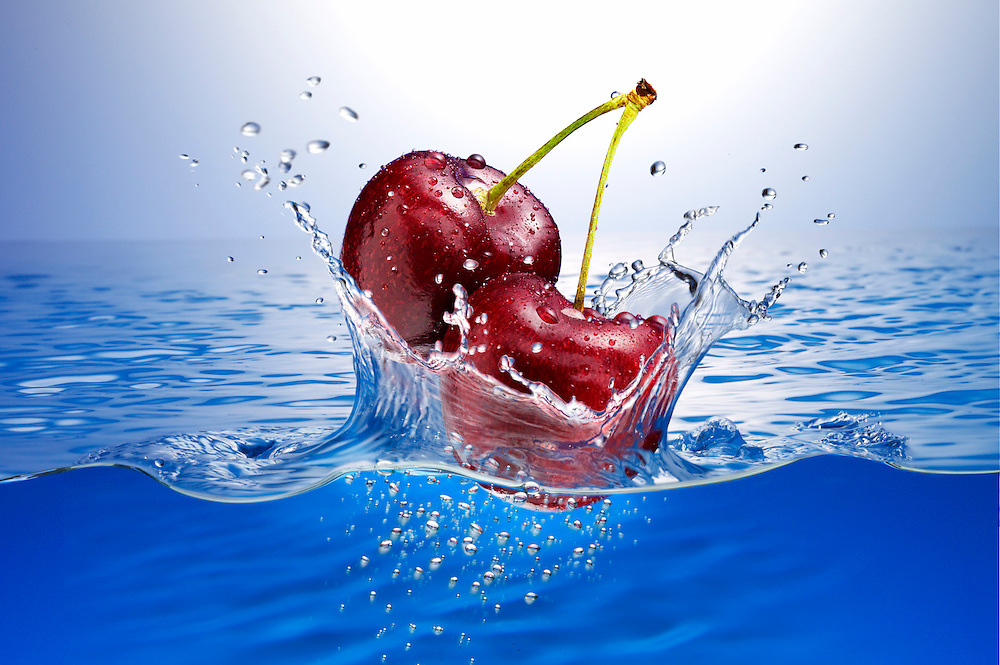 Cherries splashing into water Ray Massey is an established, award winning, UK professional  photographer, shooting creative advertising and editorial images from his stunning studio in a converted church in Camden Town, London NW1. Ray Massey specialises in drinks and liquids, still life and hands, product, gymnastics, special effects (sfx) and location photography. He is particularly known for dynamic high speed action shots of pours, bubbles, splashes and explosions in beers, champagnes, sodas, cocktails and beverages of all descriptions, as well as perfumes, paint, ink, water – even ice! Ray Massey works throughout the world with advertising agencies, designers, design groups, PR companies and directly with clients. He regularly manages the entire creative process, including post-production composition, manipulation and retouching, working with his team of retouchers to produce final images ready for publication.