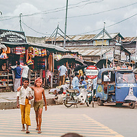 Motor scooters line up at an outdoor bazaar in  Dhaka, Bangladesh in 1977.