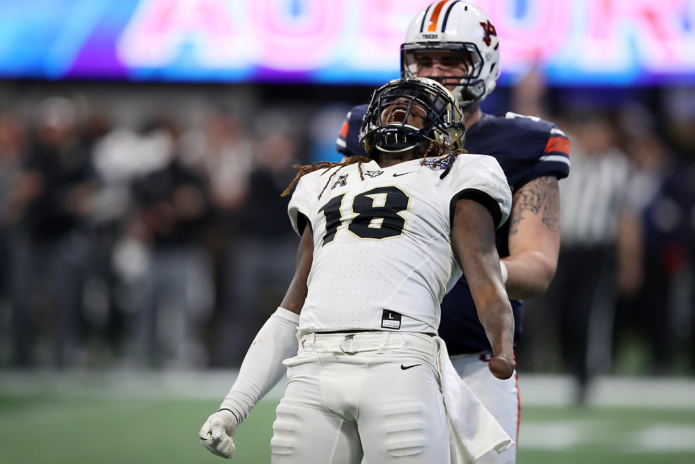 UCF Knights linebacker Shaquem Griffin (18) celebrates a play during the 2018 Chick-fil-A Peach Bowl NCAA football game against the Auburn Tigers on Monday, January 1, 2018 in Atlanta. (Jason Parkhurst / Abell Images for the Chick-fil-A Peach Bowl)