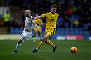 Marcus Maddison of Peterborough United is fouled by Rob Dickie of Oxford United during the EFL Sky Bet League 1 match between Oxford United and Peterborough United at the Kassam Stadium, Oxford, England on 16 February 2019.