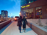 Zwei junge Frauen eingehuellt in warme Kleidung vor dem Polar Star Hotel in der sibirischen Stadt Jakutsk bei einer Temperatur von -30 Grad Celsius.<br /> <br /> Two young women wrapped in warm clothes in front of the Polar Star hotel in Yakutsk during a temperature of -30 degrees Celsius. Yakutsk is a city in the Russian Far East, located about 4 degrees (450 km) below the Arctic Circle. It is the capital of the Sakha (Yakutia) Republic (formerly the Yakut Autonomous Soviet Socialist Republic), Russia and a major port on the Lena River. Yakutsk is one of the coldest cities on earth, with winter temperatures averaging -40.9 degrees Celsius.