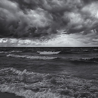 """""""As the World Turns"""" mono<br /> <br /> Beautiful tumultuous image from Lake Michigan during an autumn storm. dark skies churning, and waves crashing!!<br /> <br /> Black and White Images by Rachel Cohen"""