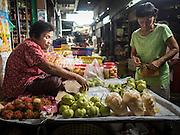 13 MAY 2015 - SAMUT SONGKRAM, SAMUT SONGKRAM, THAILAND:  A fruit vendor in the market in Samut Songkram, Thailand.       PHOTO BY JACK KURTZ