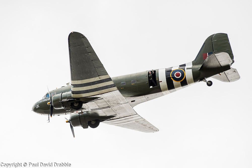Dakota ZA947 of the RAF Battle of Britain Memorial Flight is painted to represent Dakota FZ692 of No 233 Squadron, around the D-Day period in 1944. Named 'Kwicherbichen' by her crews, the aircraft was involved in Para-dropping operations on the eve of D-Day also re-supply and casualty evacuation missions into and out of forward airfields in the combat areas. The female nurses who escorted the casualties on these flights became known as 'The Flying Nightingales'.<br /> <br /> Image © Paul David Drabble<br /> www.pauldaviddrabble.co.uk
