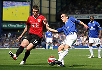 Photo: Paul Thomas.<br />Everton v Manchester United. The Barclays Premiership. 28/04/2007.<br /><br />Michael Carrick (L) of Utd tries to stop Leon Osman.