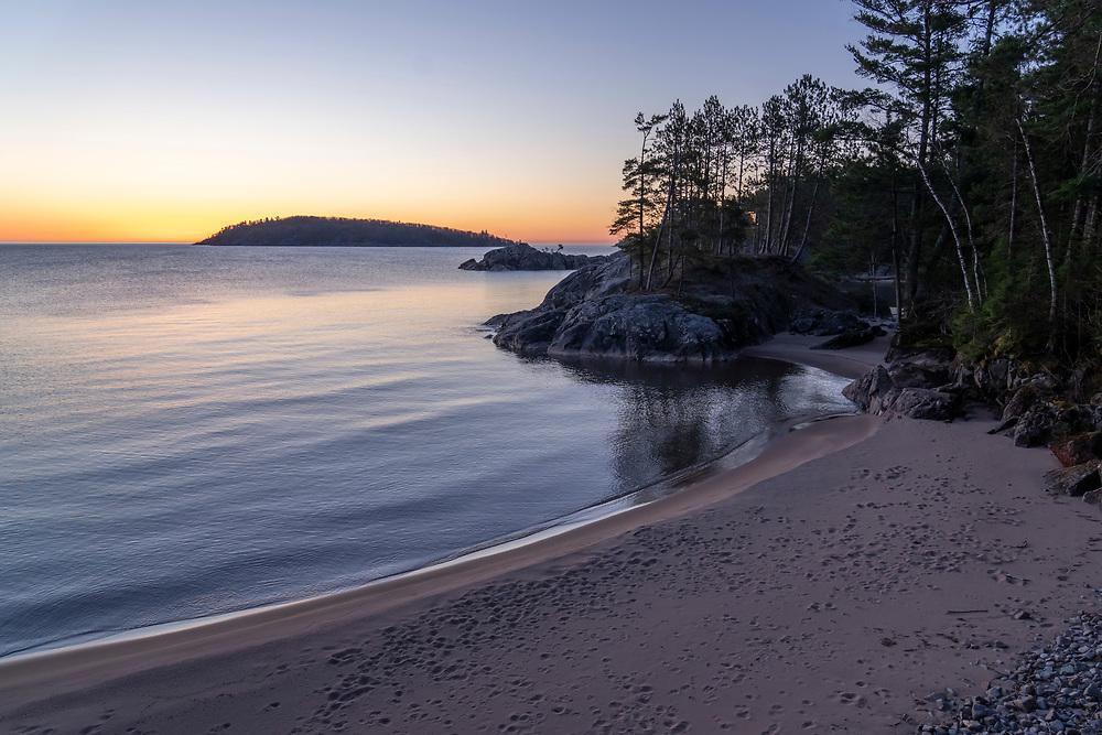 Sunrise over a Lake Superior beach at Marquette, Michigan.