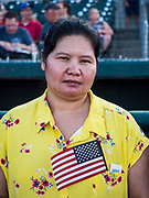 04 JULY 2019  - DES MOINES, IOWA: TA MU HTOO, originally from Myanmar, waits to become a naturalized US citizen. Thirty people became US citizens during a naturalization ceremony at the Iowa Cubs game in Des Moines. The naturalization ceremony is an Iowa Cubs 4th of July tradition. This is the 11th year they've held the ceremony.           PHOTO BY JACK KURTZ