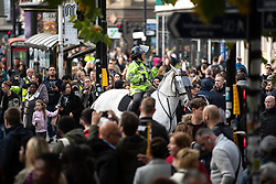 © Licensed to London News Pictures . 20/10/2018 . Manchester , UK . Mounted police separate members of the public , counter protesters and EDL supporters as police contain approximately 50 EDL supporters in Piccadilly Gardens . Street protest movement , the English Defence League ( EDL ) , hold a demonstration , opposed by anti-fascists , including Unite Against Fascism ( UAF ) , in Manchester City Centre . Amongst the reasons for their protest , the EDL cite news reports that revealed an imam at the Didsbury Mosque where Manchester Arena bomber Salman Abedi prayed , praised armed jihad in a sermon delivered just days before Abedi bought a ticket for the Ariana Grande concert at which he killed twenty two people . Photo credit : Joel Goodman/LNP