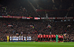 A general view of the minutes applause for Sir Matt Busby on the 25th anniversary of his death
