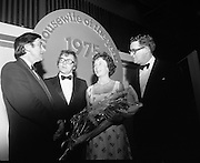 Housewife Of The Year Final.        (J91).1975..25.11.1975..11.25.1975..25th November 1975..The Housewife Of The Year Final took place today at Jury,s Hotel,Ballsbridge,Dublin. The event was sponsored by Mc Donnells, Calor/Kosangas and Woman's Way magazine. The show was compered by Mr Mike Murphy from RTE..The finalists were:.Mrs Geraldine Cronin,Nenagh,Co Tipperary..Mrs Deirdre Dolan,Passage West,Co Cork..Mrs Barbara Hartigan,Castleconnell,Co Limerick..Mrs Frances Twomey,Castlebar, Co Mayo..Mrs Susanne Browne,Lifford, Co Donegal..Mrs Lilian Murphy, Dunshaughlin,Co Meath..Mrs Eileen Jones,Donabate, Co Dublin..The sevenfinalists were selected from a group of eighty four entrants.The cookery section was judged by Paula Daly,McDonnell's Good Food Kitchen,Liz Boyhan,Calor Kosangas and Honor Moore, Woman's Way..Image taken as Mrs Barbara Hartigan is congratulated by the sponsors and presented with a bouquet after her success in becoming housewife Of The Year