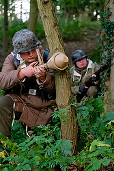 Reenactors dressed in late War German winter clothing both are wearing Parkas and Steel helmets, Short Boots and Gaiters carrying the Mauser K98 Rifle. One also has a Panzerfaust antitank weapon<br /> <br /> September 2019<br /> All Images Copyright Paul David Drabble -<br /> All rights Reserved -<br /> Moral Rights Asserted -
