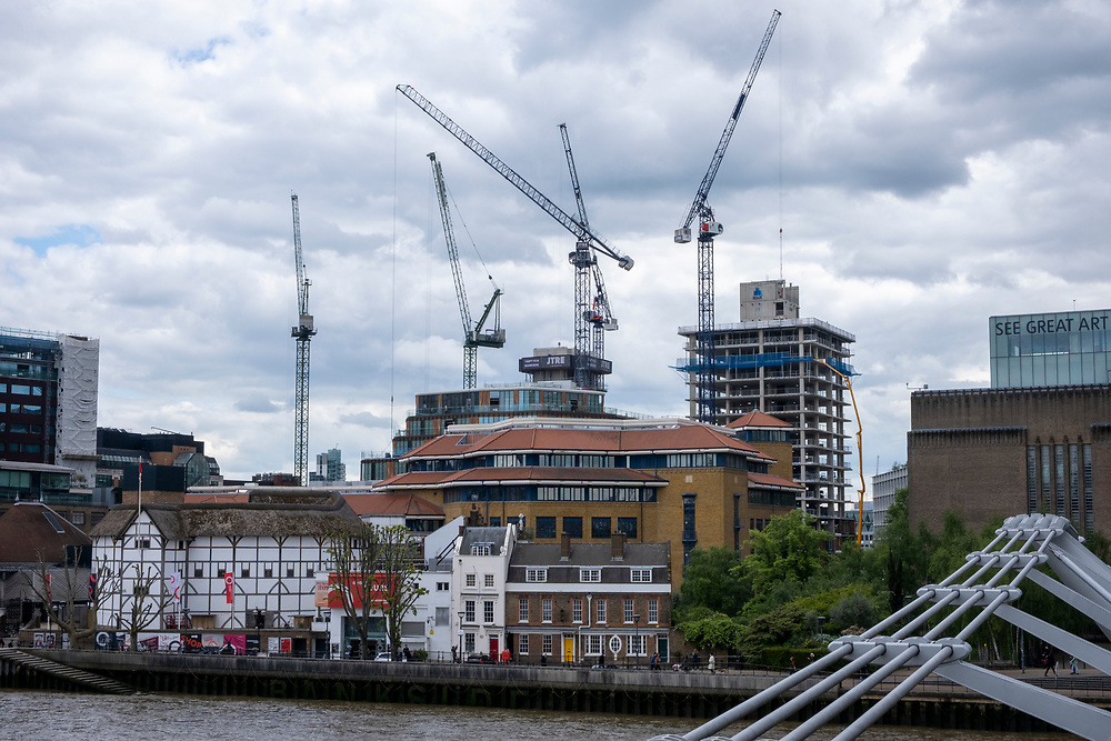 Construction cranes on London's skyline above Shakespeare's Globe theatre on the 25th of May 2021 in London, England. (photo by Andrew Aitchison / In pictures via Getty Images)
