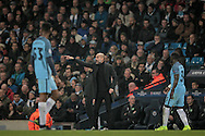 Josep Guardiola (Manager)(Manchester City) shouts instructions to his players during the Champions League match between Manchester City and Celtic at the Etihad Stadium, Manchester, England on 6 December 2016. Photo by Mark P Doherty.