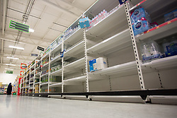© Licensed to London News Pictures.  20/09/2021. London, UK. Empty shelves are seen in Asda Stepney Green, east London as CO2 shortage can hit food suppliers in the UK within days. Photo credit: Marcin Nowak/LNP