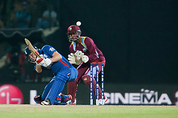 © Licensed to London News Pictures. 27/09/2012. English batsmen Jonny Bairstow hits the ball over his head during the T20 Cricket World super 8's match between England Vs West Indies at the Pallekele International Stadium Cricket Stadium, Pallekele. Photo credit : Asanka Brendon Ratnayake/LNP