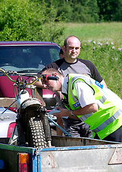 PC Peter Booth checks out an off road motorbike during a police operation against illegal off road biking in the High Green area Sunday <br /><br />Image Copyright Paul David Drabble<br /><br />29 June 2003<br /><br />Copyright  Paul David Drabble<br /><br />[#Beginning of Shooting Data Section]<br />Nikon D1 <br /><br />2003/06/29 09:36:56.2<br /><br />JPEG (8-bit) Fine<br /><br />Image Size:  2000 x 1312<br /><br />Color<br /><br />Lens: 80-200mm f/2.8-2.8<br /><br />Focal Length: 120mm<br /><br />Exposure Mode: Programmed Auto<br /><br />Metering Mode: Multi-Pattern<br /><br />1/250 sec - f/8<br /><br />Exposure Comp